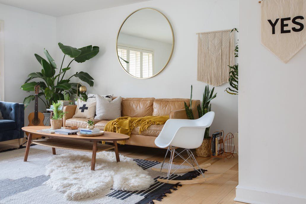 Our oversized Metal Framed Mirror and Hamilton Leather sofa spotted in this light, bright living room of Erin Barrett! Seen on Apartment Therapy.