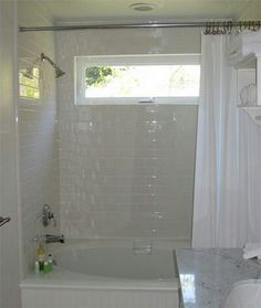 Transom Window Above Bathtub Area To Allow Natural Light Into A