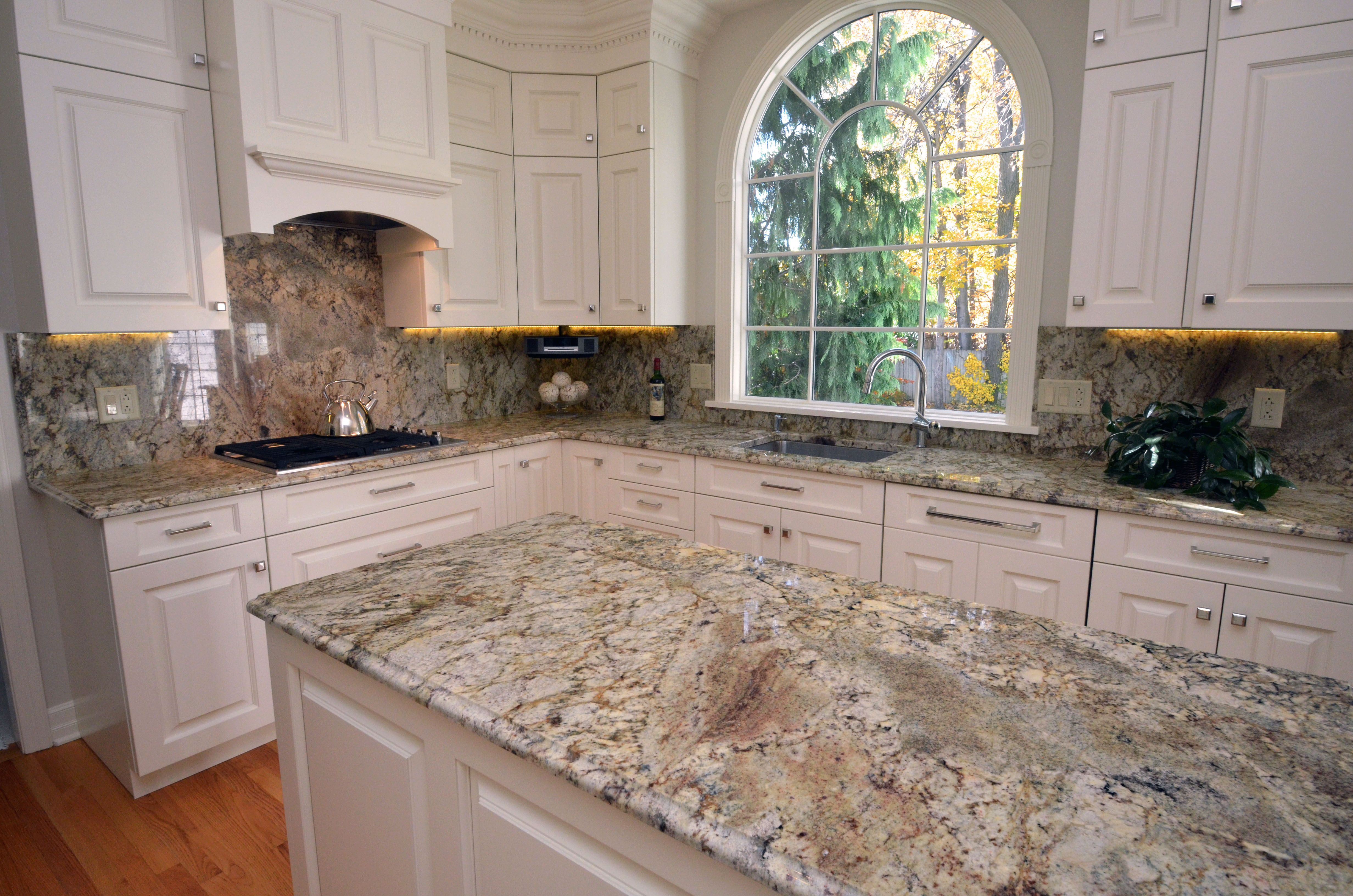 Traditional style kitchen with granite countertops and a full ...