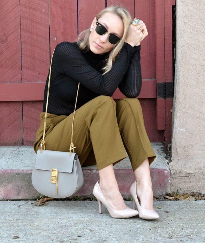 Shop this look on Lookastic:  http://lookastic.com/women/looks/sunglasses-turtleneck-skinny-pants-crossbody-bag-pumps/9465  — Black and Gold Sunglasses  — Black Turtleneck  — Olive Skinny Pants  — Grey Leather Crossbody Bag  — Beige Leather Pumps
