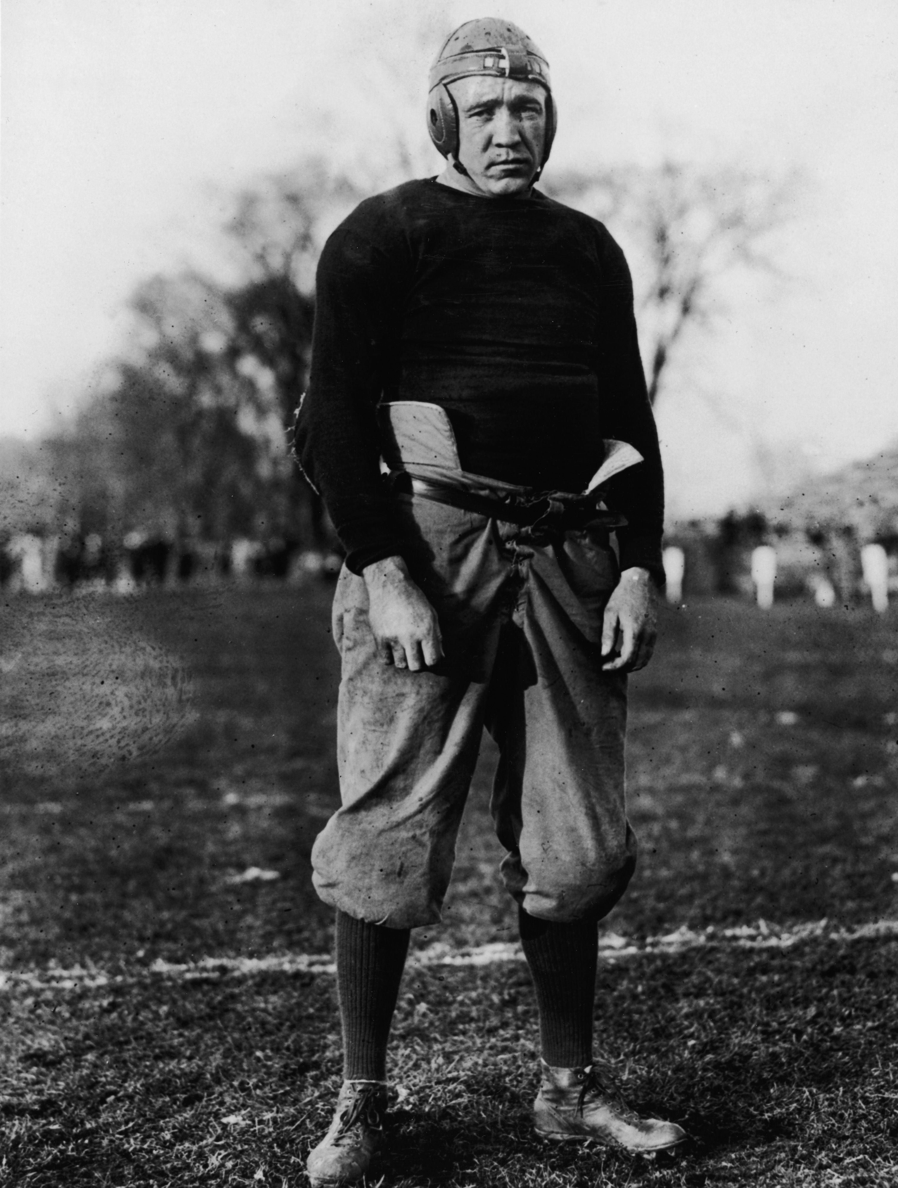 American football player and coach knute rockne 1888 1931 american football player and coach knute rockne head coach for notre dame posing in uniform on a field credit hulton archive fandeluxe Ebook collections