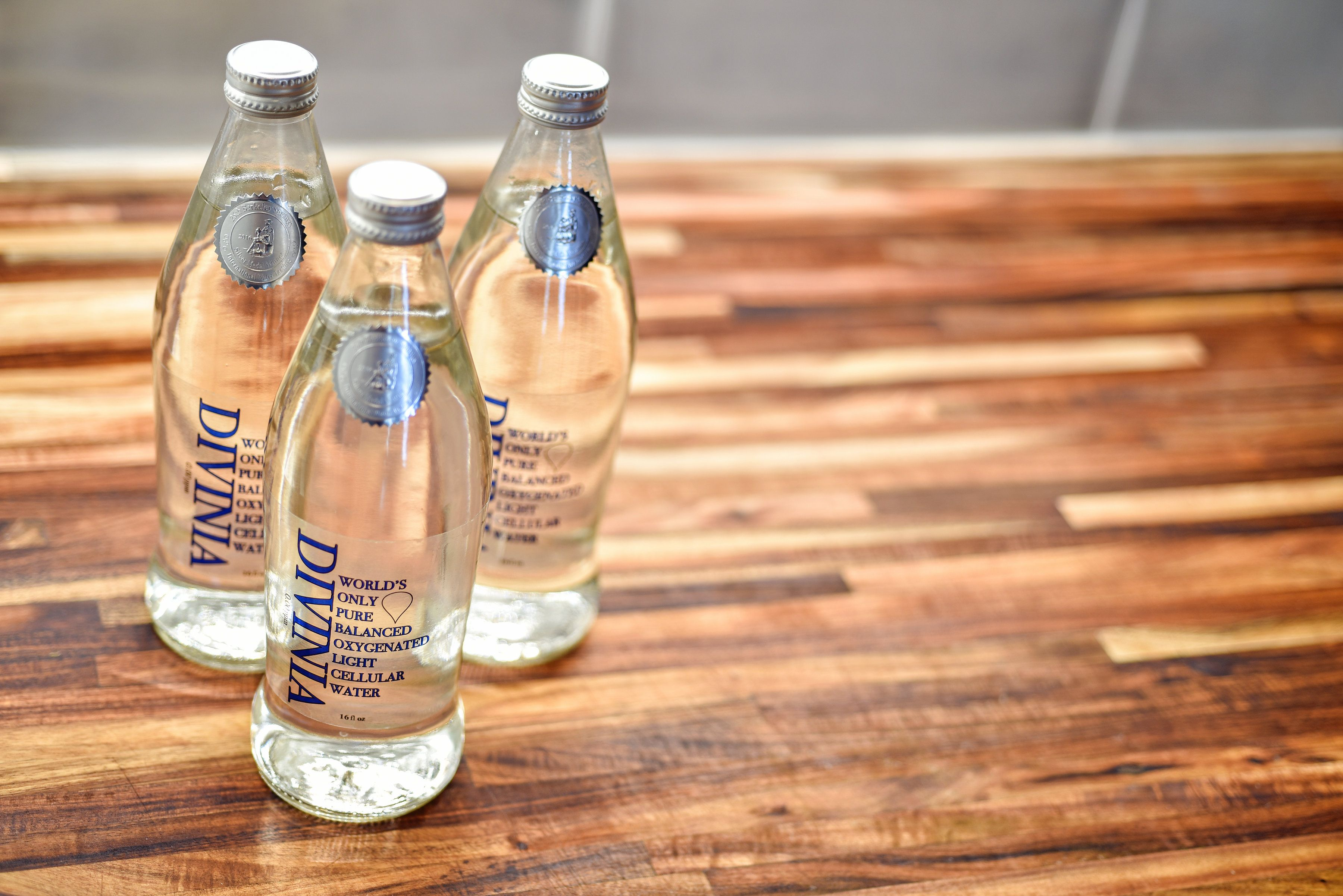 Divinia Water Is Like No Other Bottled Water Brand This Structured Water Delivers Intracellular Hydration Branded Water Bottle Structured Water Water Branding