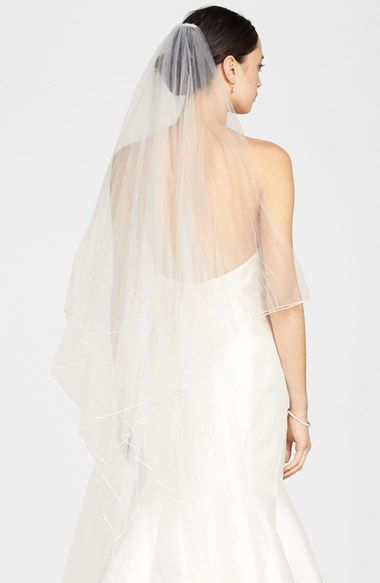 Free shipping and returns on Toni Federici 'Karma' Double Layer Ribbon Edge Veil at Nordstrom.com. Tiered, double-layered construction adds movement and depth to a fingertip veil that floats to an angled handkerchief finish. A slender band of satin ribbon at the edge polishes the style.