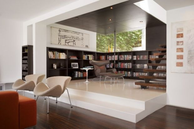 Margaret Griffin and John Enright of the LA-based Griffin Enright Architects designed this modern riff on the traditional wood-paneled library.