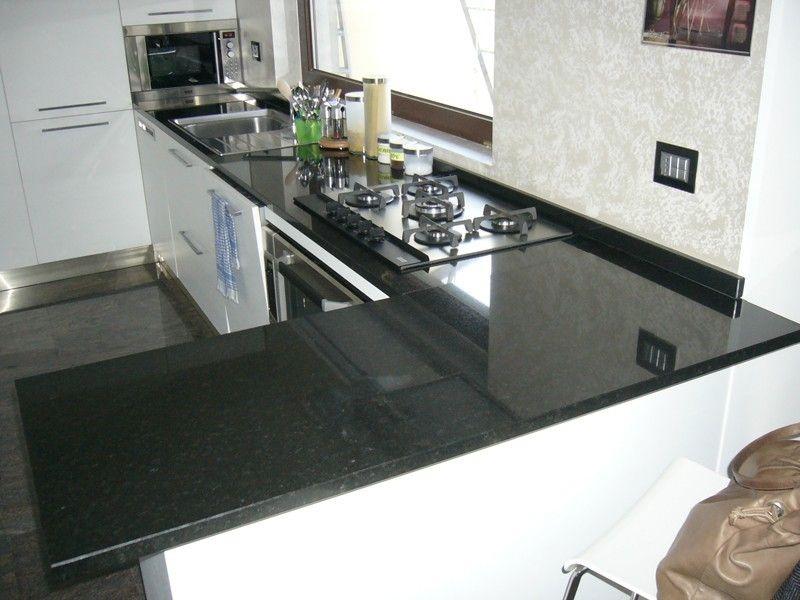 Risultati immagini per piano cucina marmo nero assoluto ...
