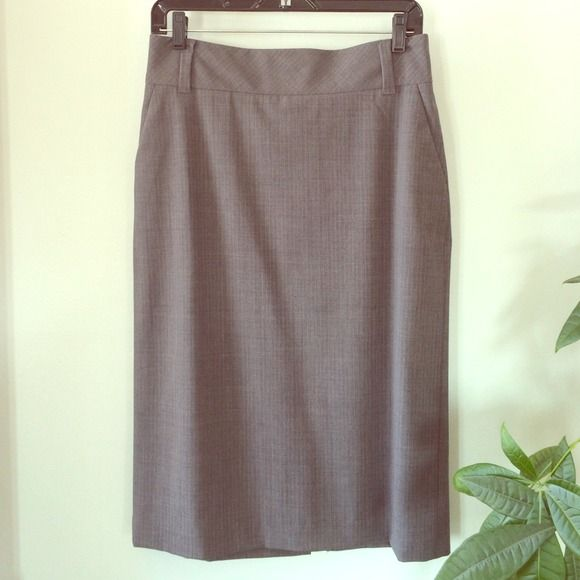 Wool pencil skirt Super cute lightweight wool pencil skirt from Banana Republic. A little bit stretchy to hug your curves. Banded waist with belt loops. Fully lined. Hidden zipper in back with two little buttons. Very good condition. Banana Republic Skirts Pencil
