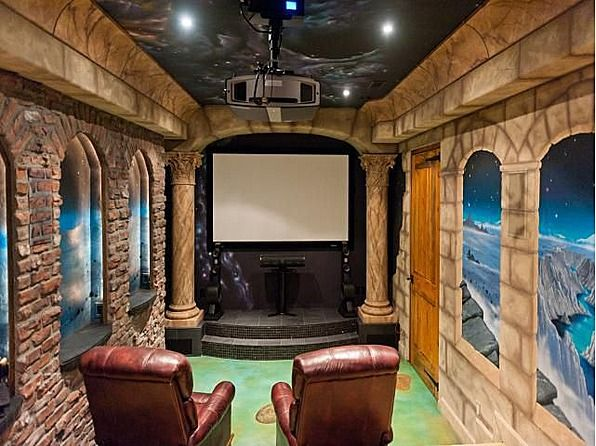 Fantasy inspired murals transport this man cave theater to another world! #hometheater #movies #art