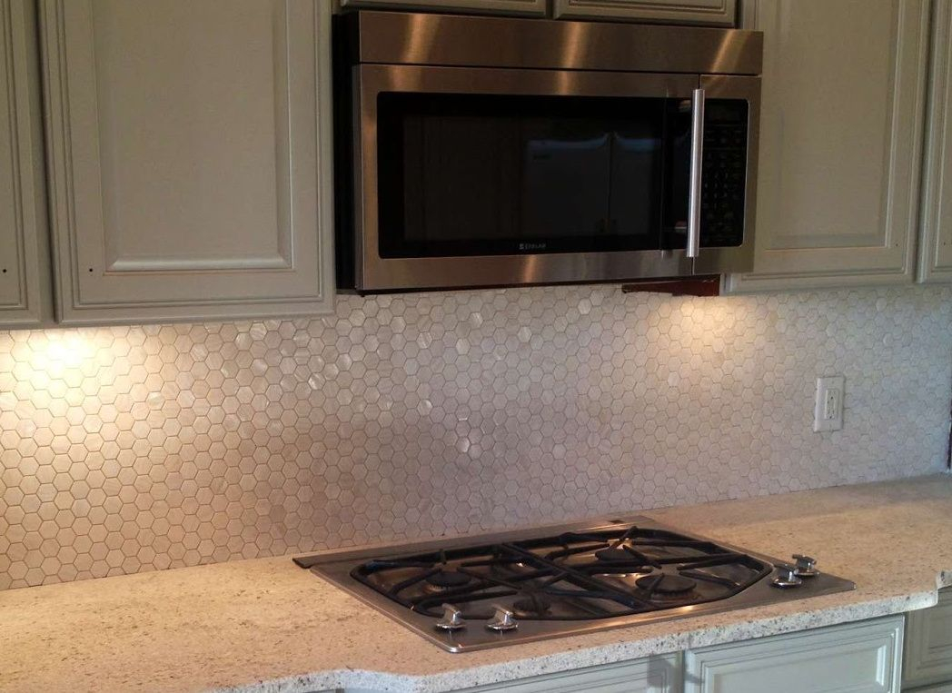 White hexagon pearl shell tile kitchen backsplash subway tiles our beautiful mother of pearl tile in iridescence white and natural tones is on a mesh dailygadgetfo Image collections