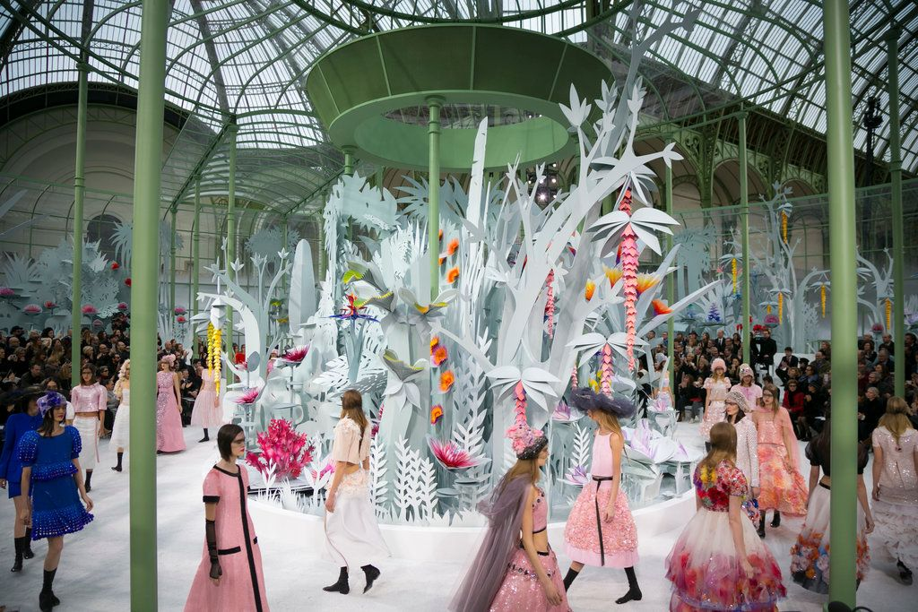 An arboretum of white cardboard palms was constructed under the glass ceiling of the Grand Palais in Paris for Karl Lagerfeld's spring couture collection.