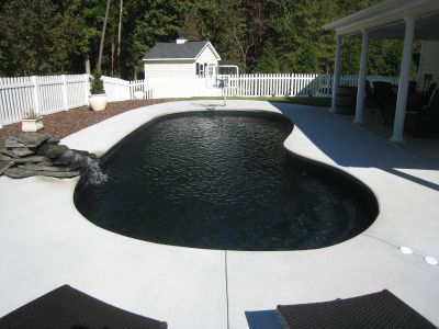 Black Tiles At The Bottom Of This Pool Give Off An Awesome Optical Illusion Let This Design Inspire You If Your Lo Black Tiles Pool Fiberglass Swimming Pools
