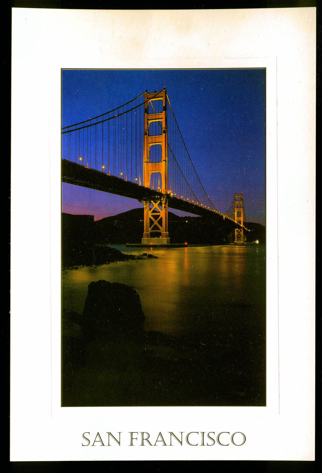 The Golden Gate Bridge reflects on the