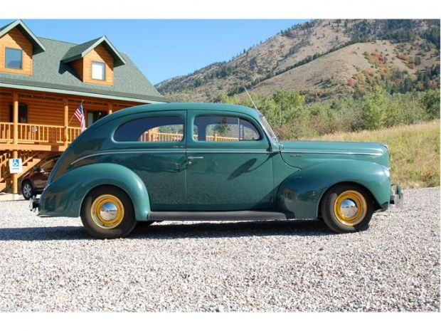 1940 Ford Tudor. This old car is painted in a beautiful blue color with yellow r…