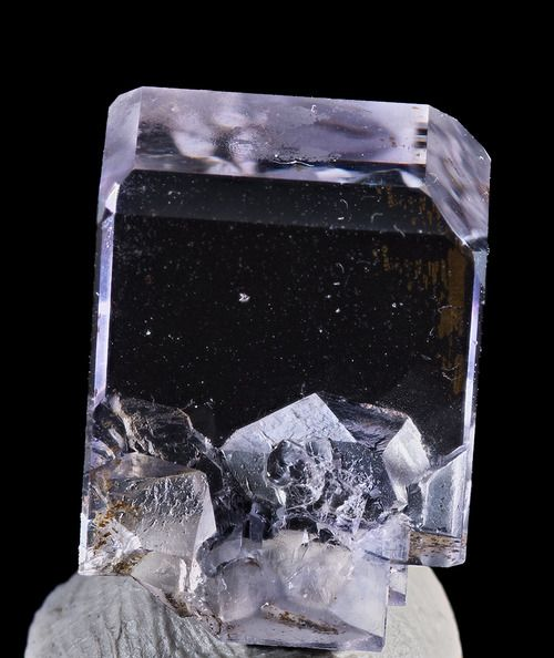 A transparent fluorite crystal with a very slight tint of lavender