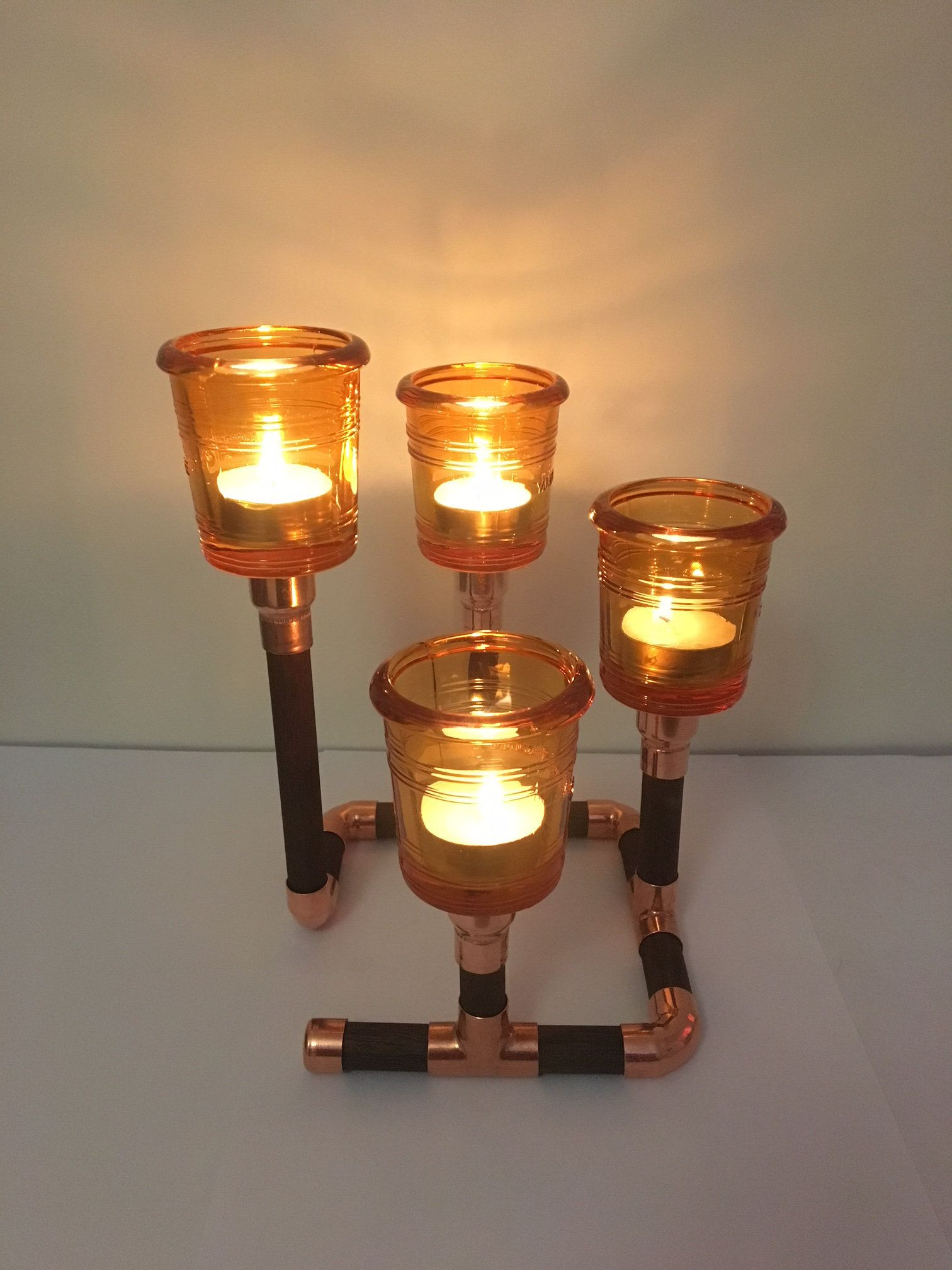 Copper candle holder with amber yankee candle bucket tea light