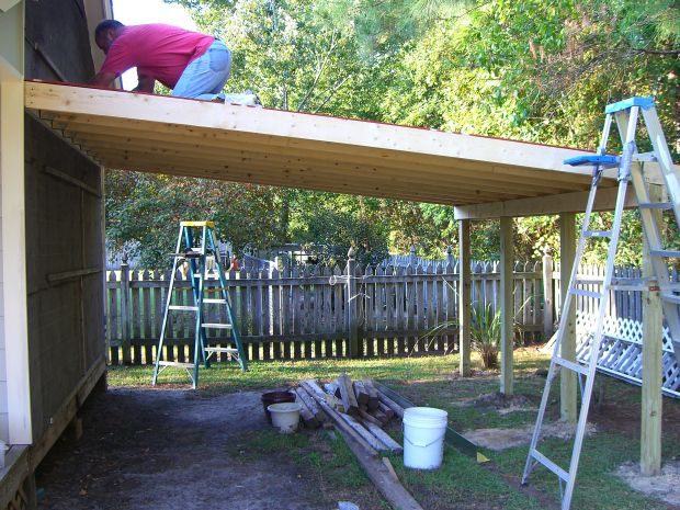 Extra wide carport designs how to build a lean to off a for Carport with attached workshop