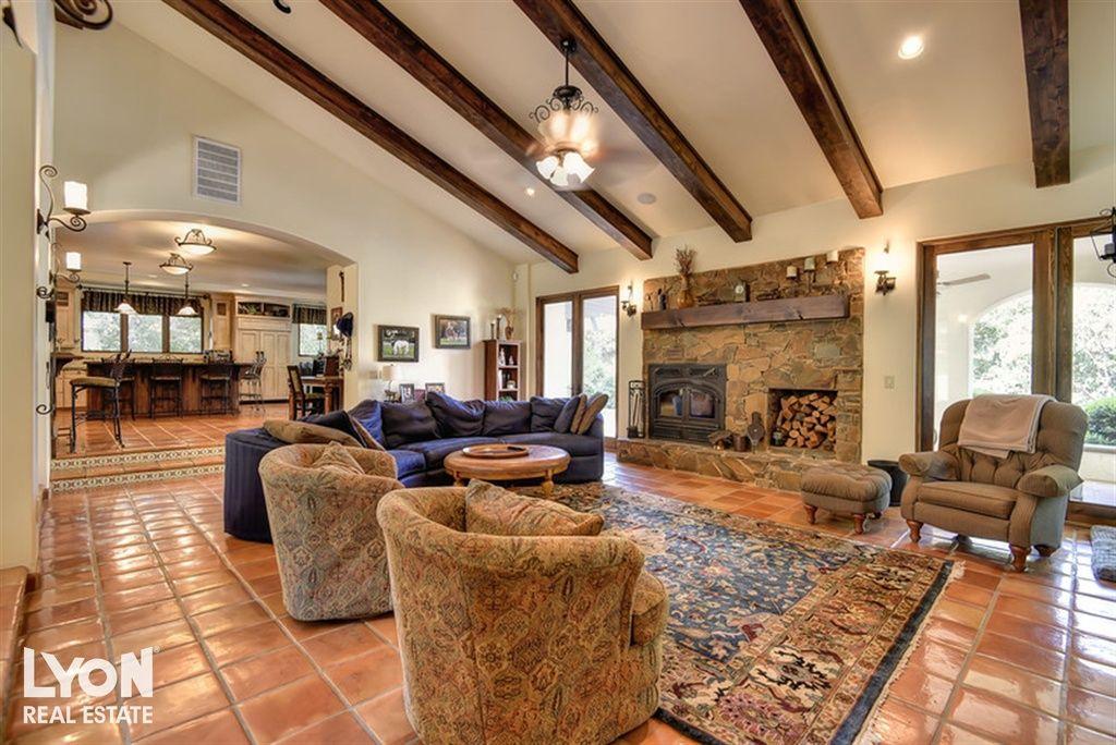 rustic living room tile floor designs | Rustic Living Room with Sunken living room, High ceiling ...