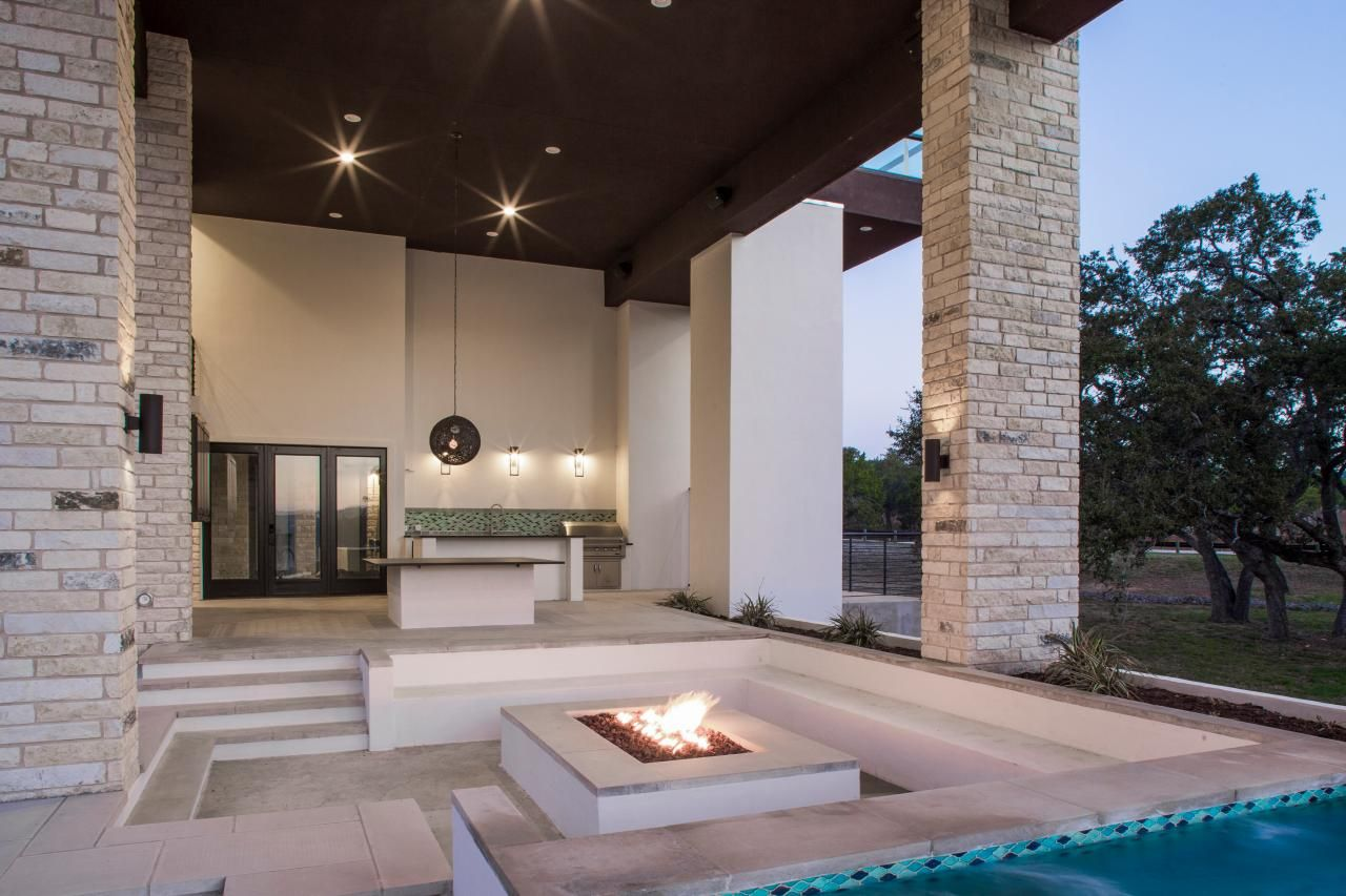 Sunken outdoor seating area with modern concrete fire pit for Fire pit seating area