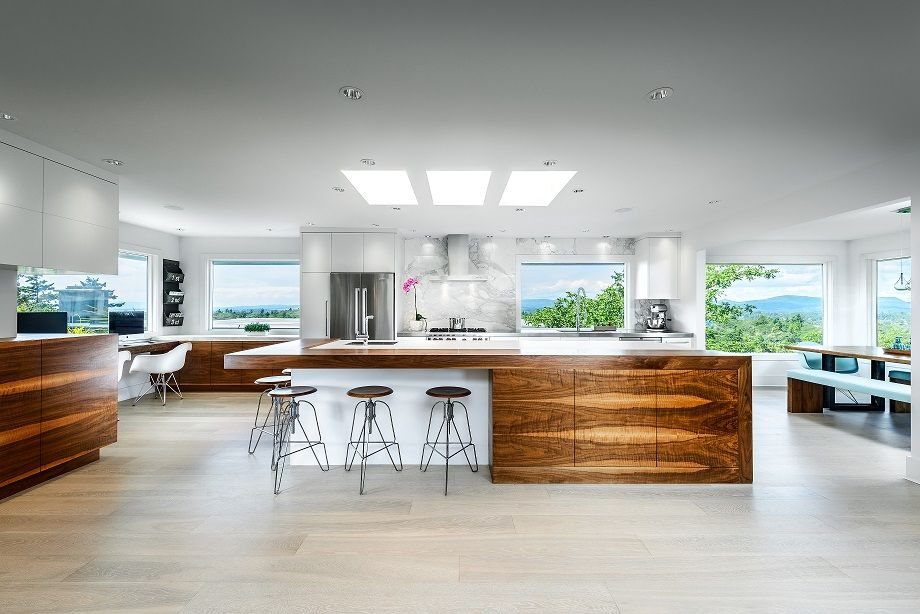 kitchen countertop in arctic white neolith with custom full height calacatta marble backsplash cabinets by