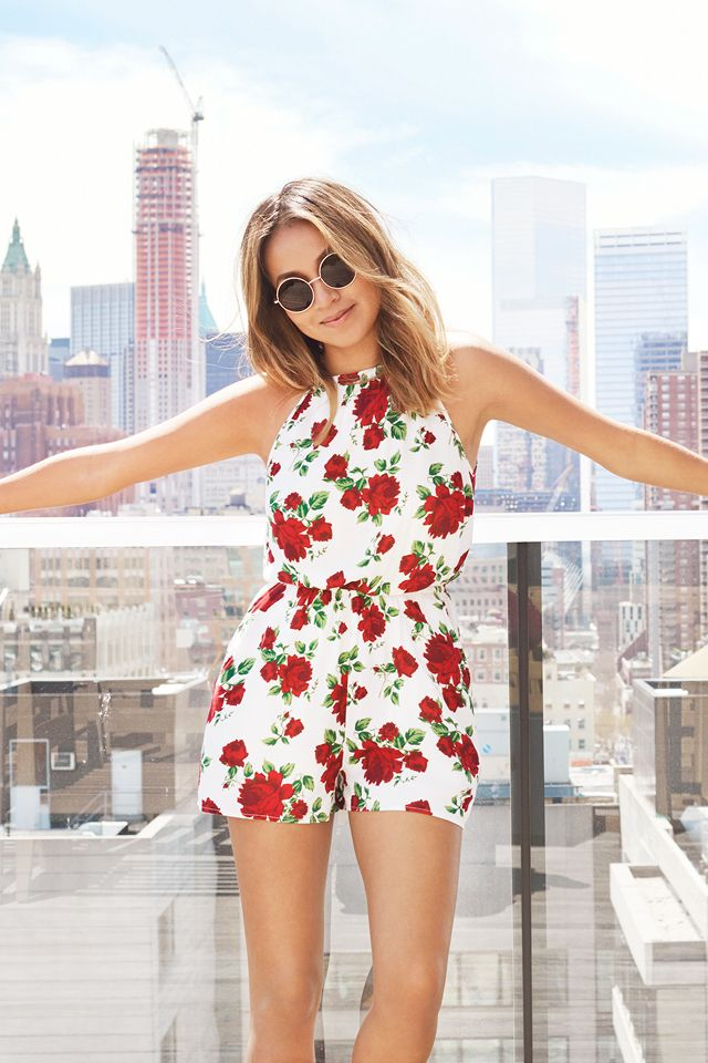 b91525667d5 Jetsetting blogger  sincerelyjules1 takes NYC in an airy white romper with  pockets and romantic red rose print.