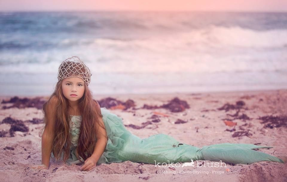 .Set up a beach photobooth with a proper tail fluke and do a photo shoot