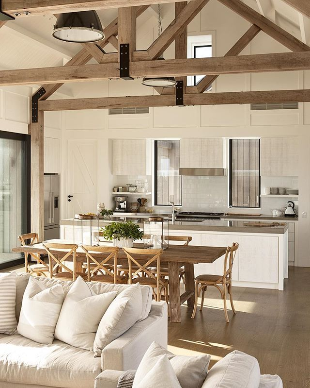 Kitchen Great Room At Dusk: Rustic Beams In This Modern Farmhouse.
