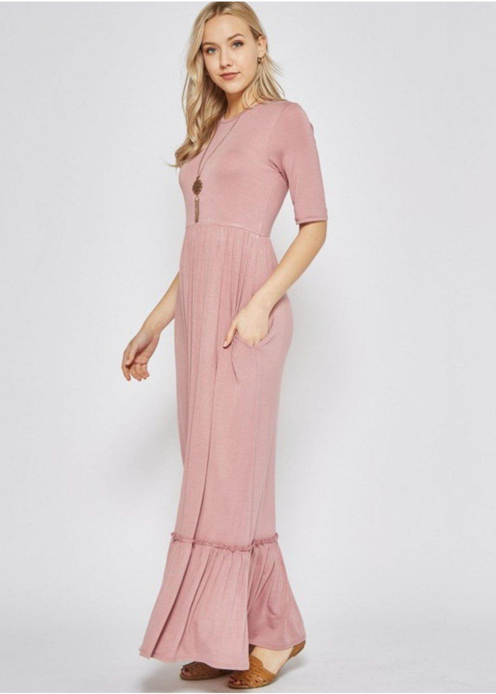 Solid rayon spandex high waist maxi dress featuring above elbow sleeve, tiered ruffle hem, and hidden pockets.