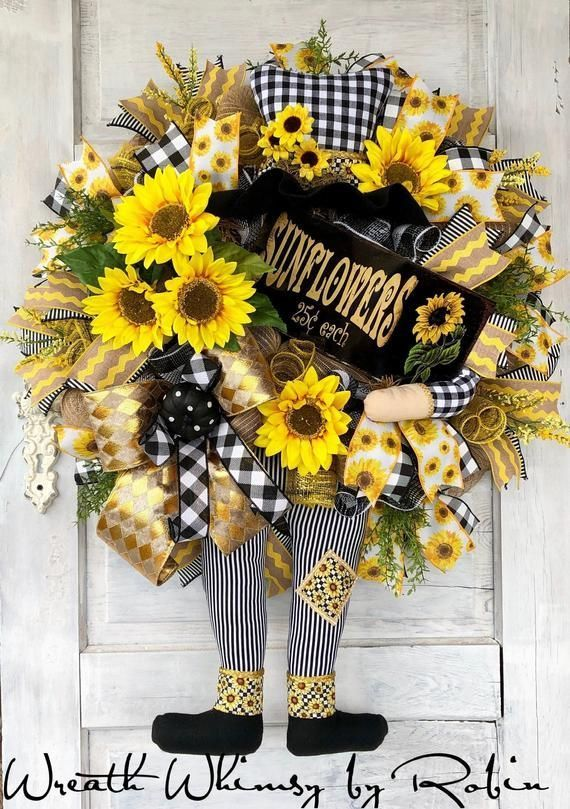 Fall Wreath, Scarecrow Wreath, Sunflower Wreath, Door Wreath, Fall Decor, Scarecrow Decor, Autumn Wreath, Scarecrow Character Wreath #scarecrowwreath Fall Wreath, Scarecrow Wreath, Sunflower Wreath, Door Wreath, Fall Decor, Scarecrow Decor, Autumn Wreath, Scarecrow Character Wreath  This fancy scarecrow is decked out in black/white plaid and stripes with sunflowers to spare!  This fall design is constructed on a base of natural colored burlap #scarecrowwreath Fall Wreath, Scarecrow Wreath, Sunfl #scarecrowwreath