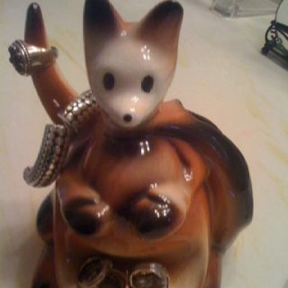 When I was a little girl, my dad, a policeman, placed all his jewelry watch and bullets onto a ceramic kangaroo  exactly like this little guy.