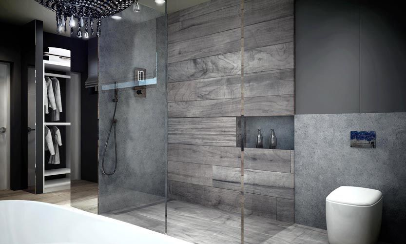 The Shower Is Encased In Glass And Features Gray Tile And