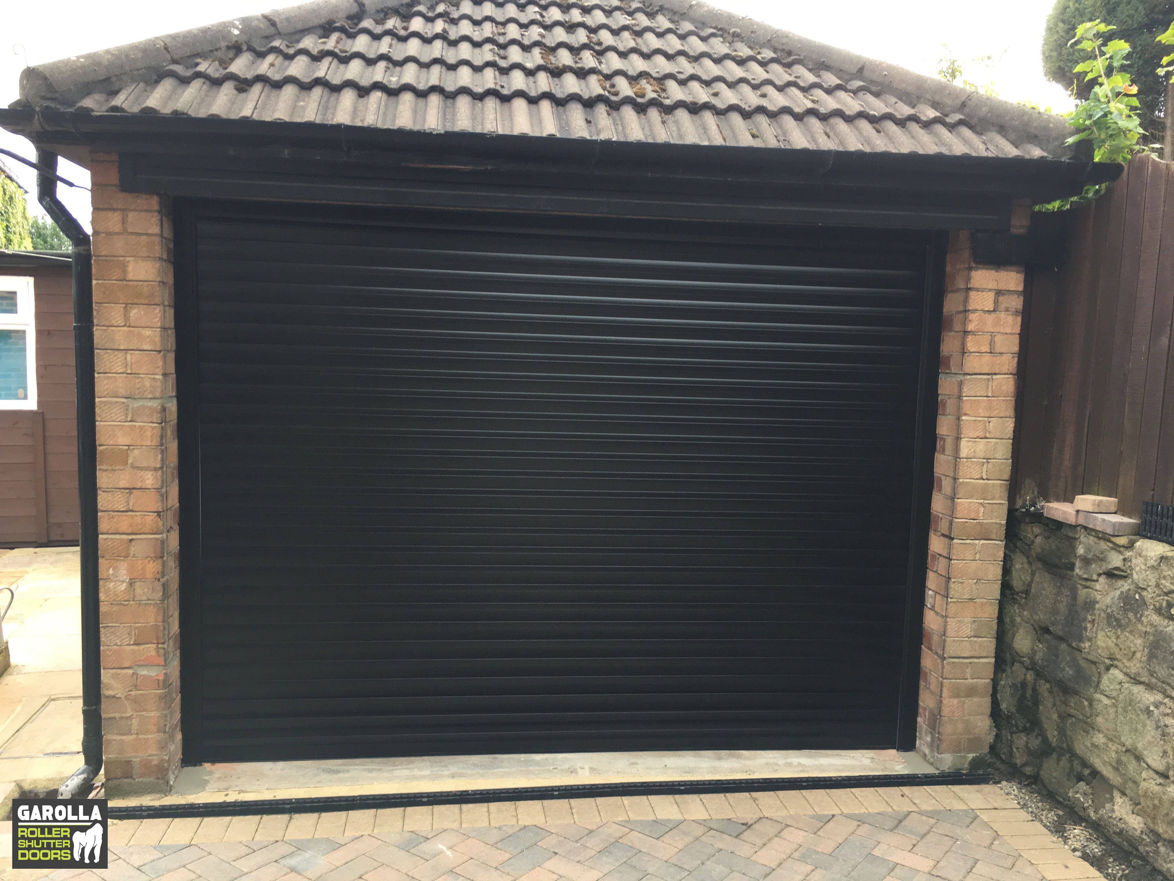 Roller Shutter Garage Door In Black Garage Doors Garage Door Design Garage Door Cost