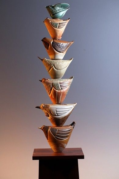 """Laurie Landry...learning to fly  wheel-thrown and altered birds, hand-carved and stacked on custom wooden pedestal (for indoor use). Also, outdoor ones about 31"""" with available 24"""" wooden bases...."""