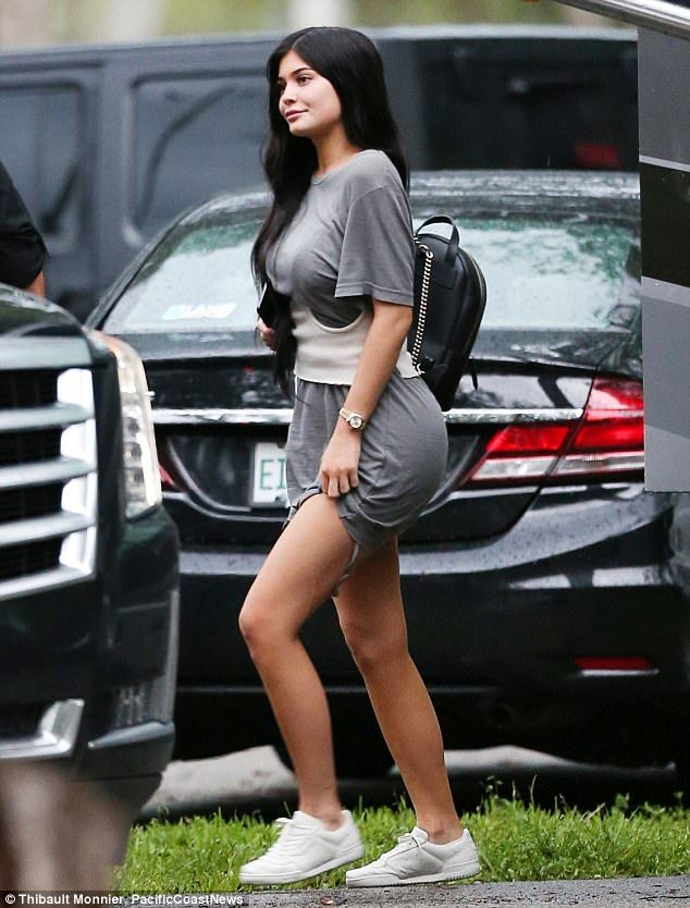 80e1c745841 Kylie Jenner shows off legs in grey mini dress with beau Travis Scott