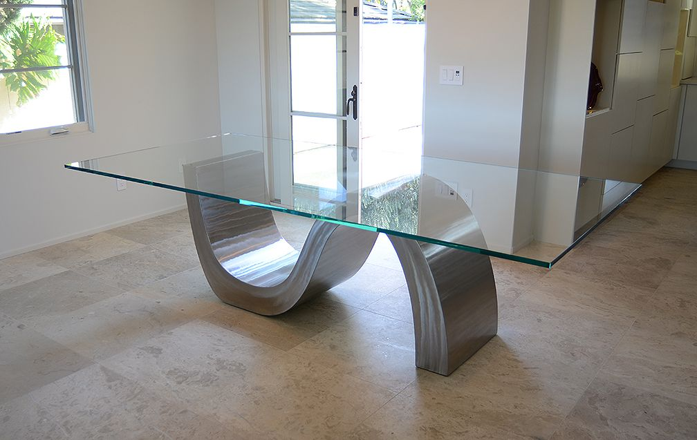 Triumphant Table Is A Large Modern Stainless Steel Dining Table