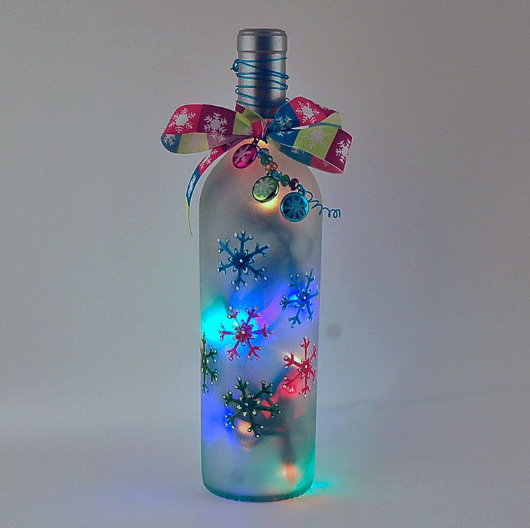 Wine bottle light multicolored snowflakes christmas for Christmas bottle decorations
