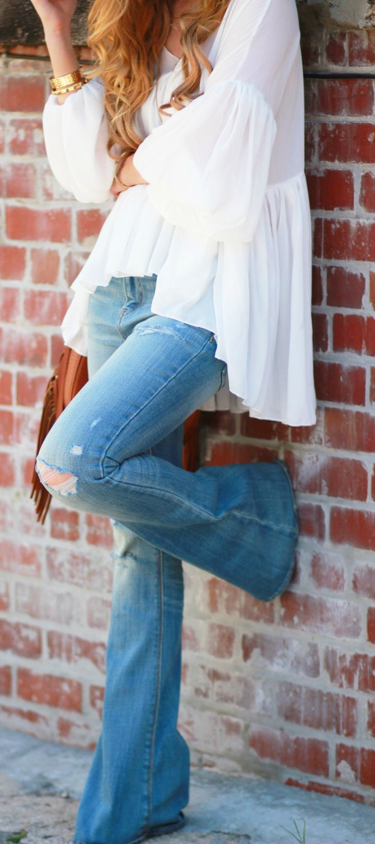 Stitch Fix Spring Summer 2017 inspiration!  Love this adorable boho vibe of this outfit with white peasant top and flared jean.  Such a great look!!  Try Stitch Fix today to receive styles just like these.  Simply click the picture, fill out your style profile and start customizing your wardrobe today!! Who doesn't want hand picked styles delivered right to their door?! #StitchFix #sponsored