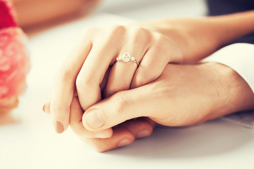 Holding Hands With Engagement Rings