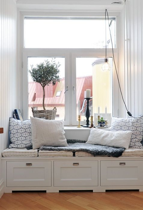 I have always wanted a bench window!  looks like a cozy place to lay and read.
