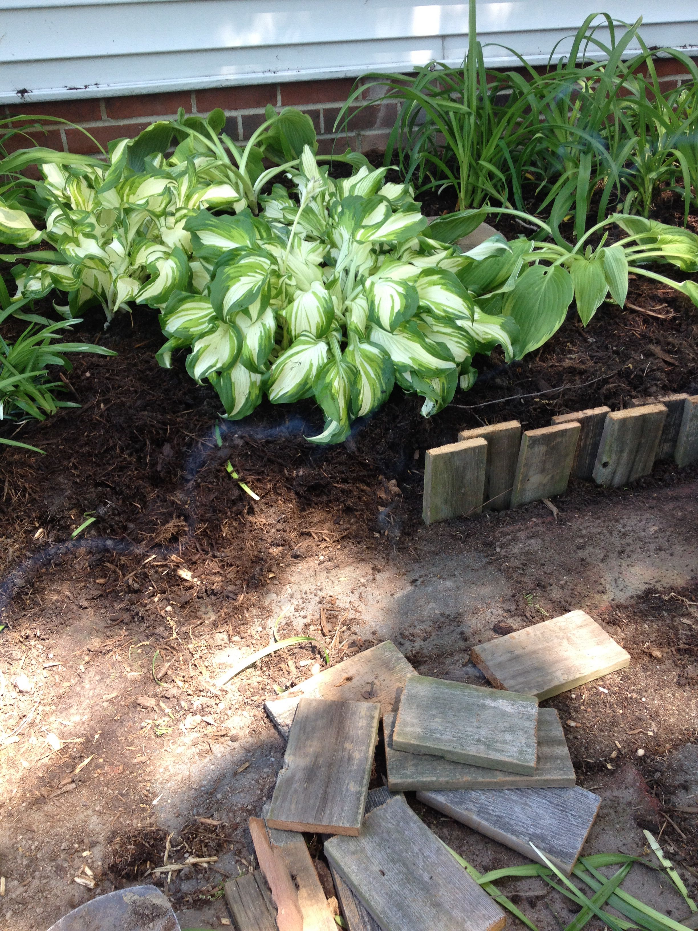 Pallet wood cut in short pieces make a great flower bed border ...