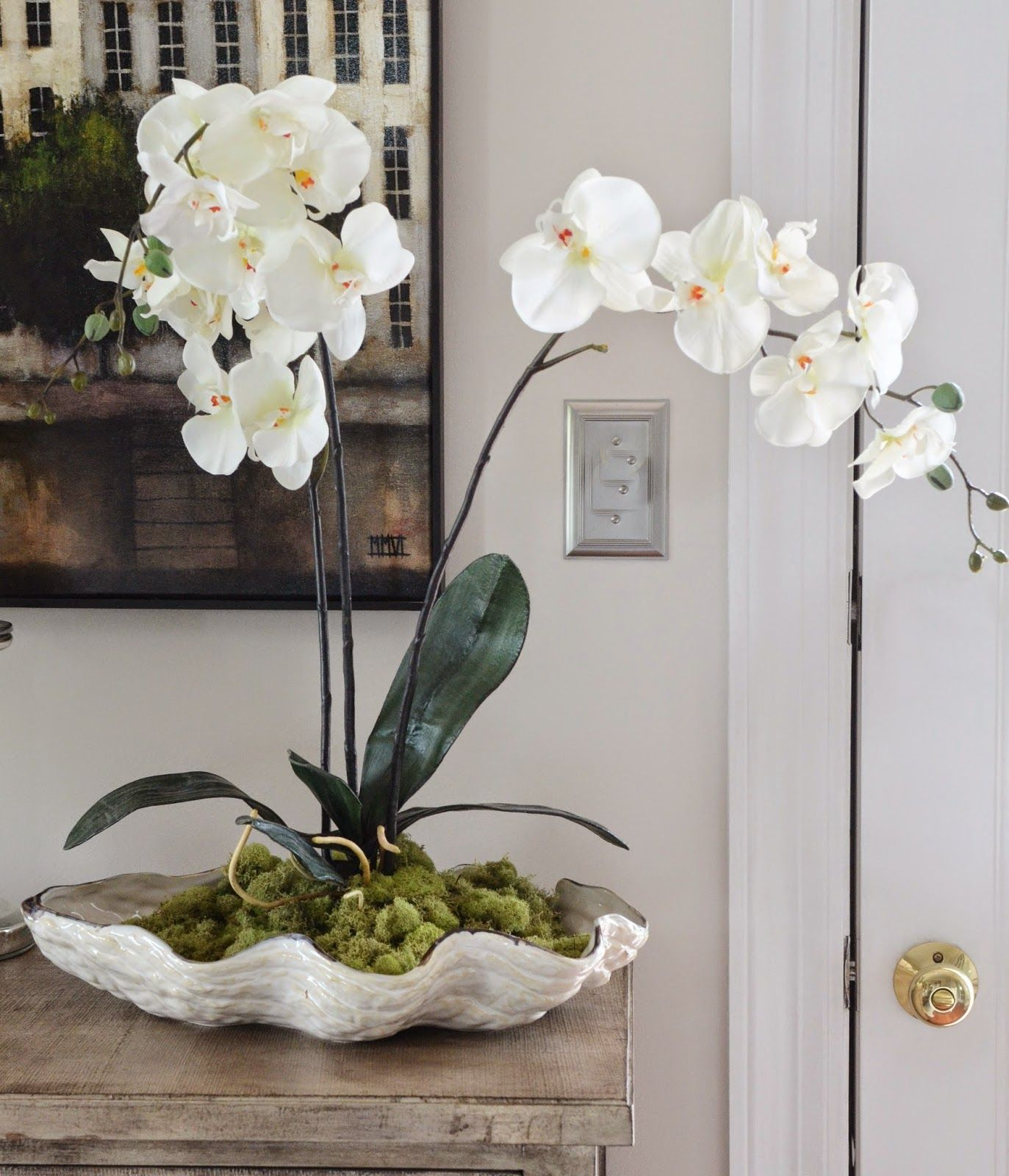 Orchids in a shell diy centerpieces clam shells