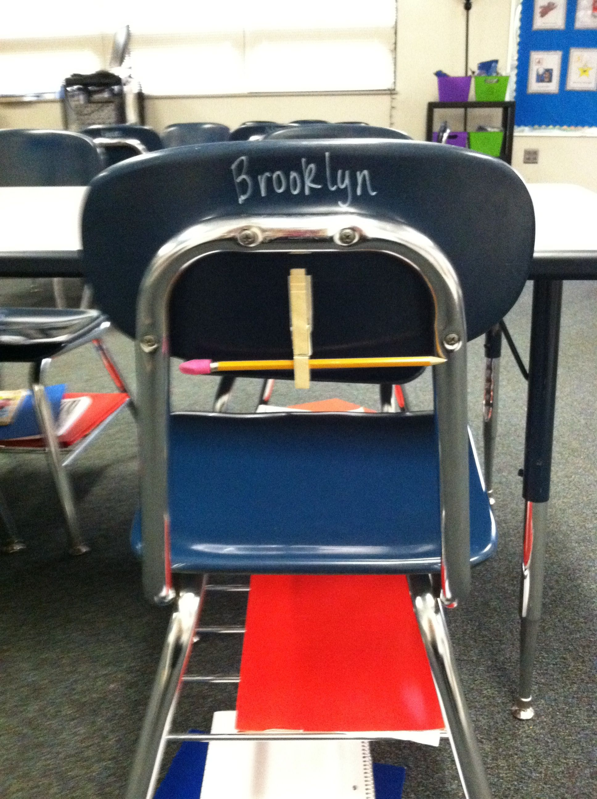 Clothespin and command strip on back of students desk to
