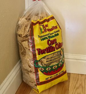the gigantic 3 bag of costco tortilla chips has been sitting on the floor in the corner of our kitchen for three weeks if you have a costco card