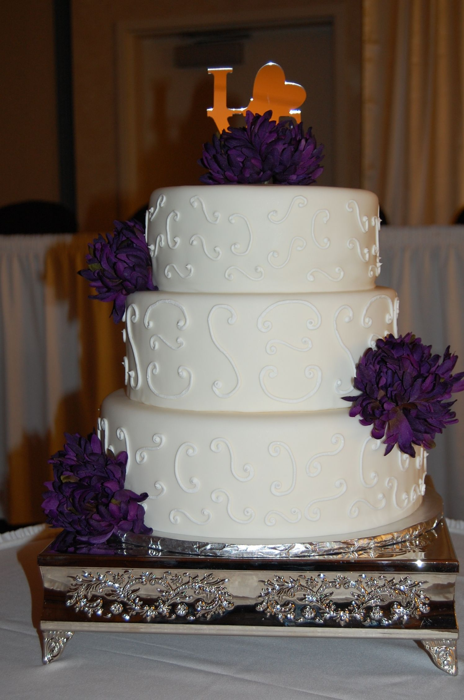 3 tier round wedding cake, scroll piping on sides, faux flowers ...
