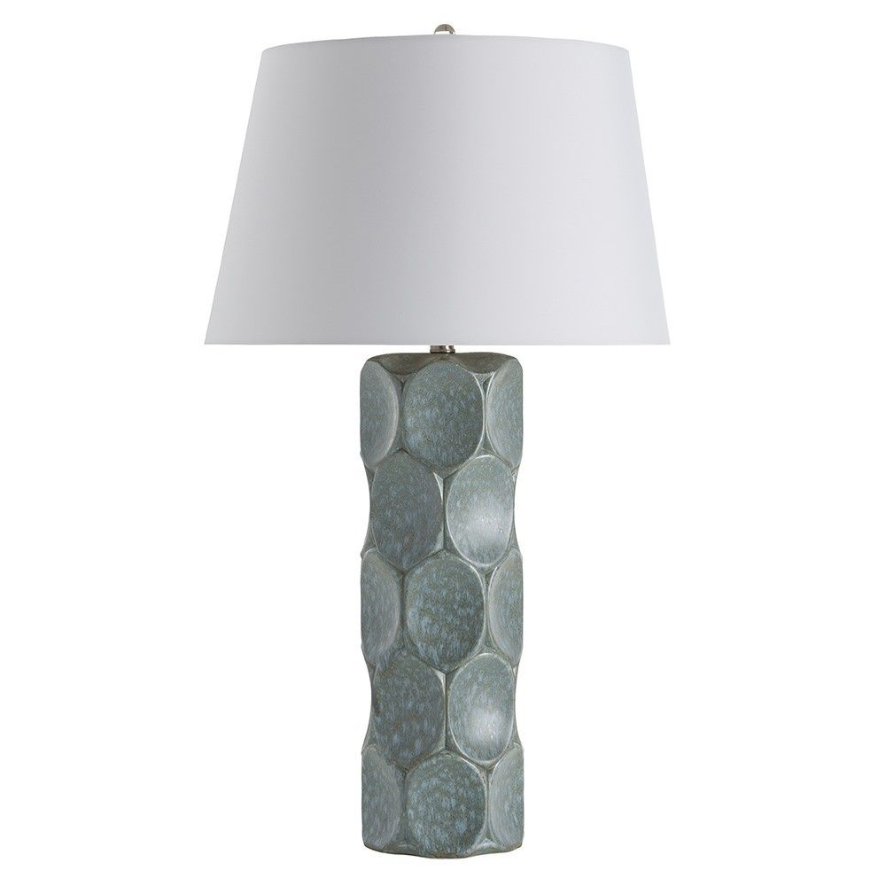 """This porcelain cylinder lamp, inspired by geometric shapes, has a surface pattern of concave divots that have been finished in a sky blue reactive glaze to create the spot-like pattern. The drum shade is made of a white microfiber, lined in gray microfiber.  Material: Porcelain, Acrylic Finish: Sky Blue Reactive Glaze Shade: White Microfiber Round Drum Shade Dimensions: 15""""W Top x 19""""W Bottom x 12""""H"""