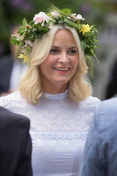 Norwegian Royal Ladies attend a garden party during the Royal Silver Jubilee Tour on June 23, 2016 in Trondheim, Norway with flowers on their head.