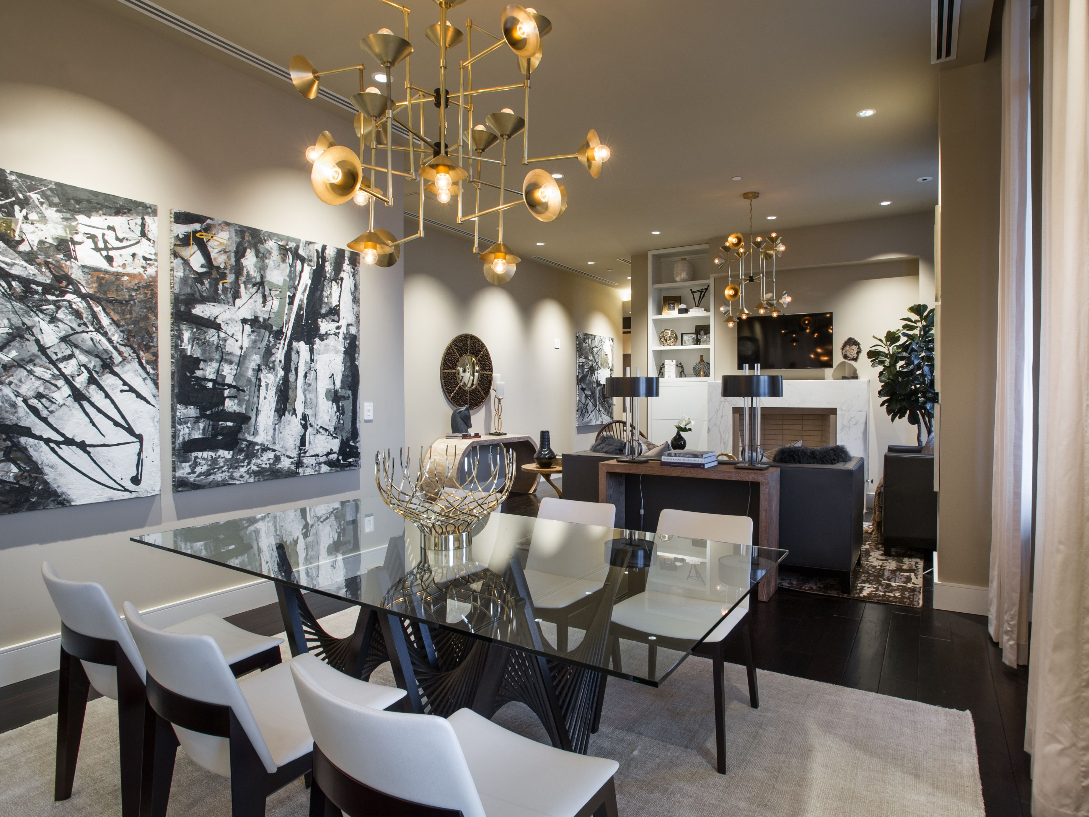 Gorgeous dining room Love the glass topped table and dramatic art