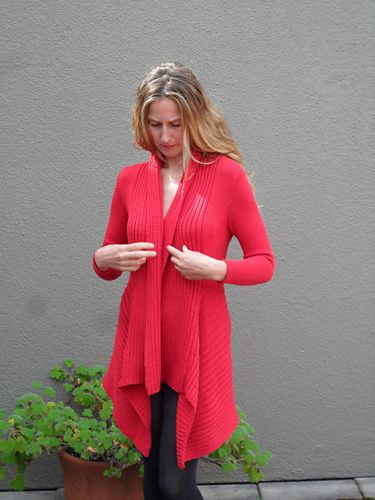 This dress-up or dress-down au current jacket is bordered by a ribbed shawl collar that drapes diagonally with the attached ribbed bottom. It looks complicated, but all of the shaping is done in stockinette. The instructions include four women's sizes: small (32-34 in/81-86 cm) medium (36-38 in/91.5-96.5 cm), large (40-42 in/101.5-106.5 cm) and extra-large (44-46 in/111.5=117 cm).