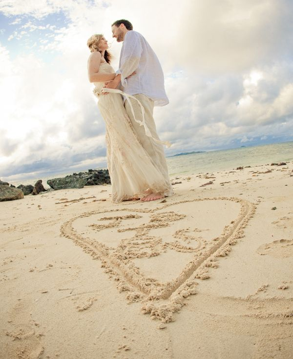 Another Writing In The Sand Pose Beach Wedding