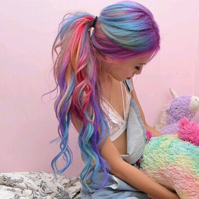 pastel dyed rainbow hair. ponytail