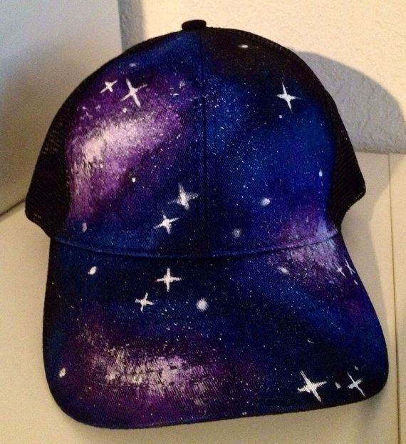 2bc786a905a This SnapBack trucker hat features a unique galaxy design painted by hand.  Each one is original and cannot be replicated