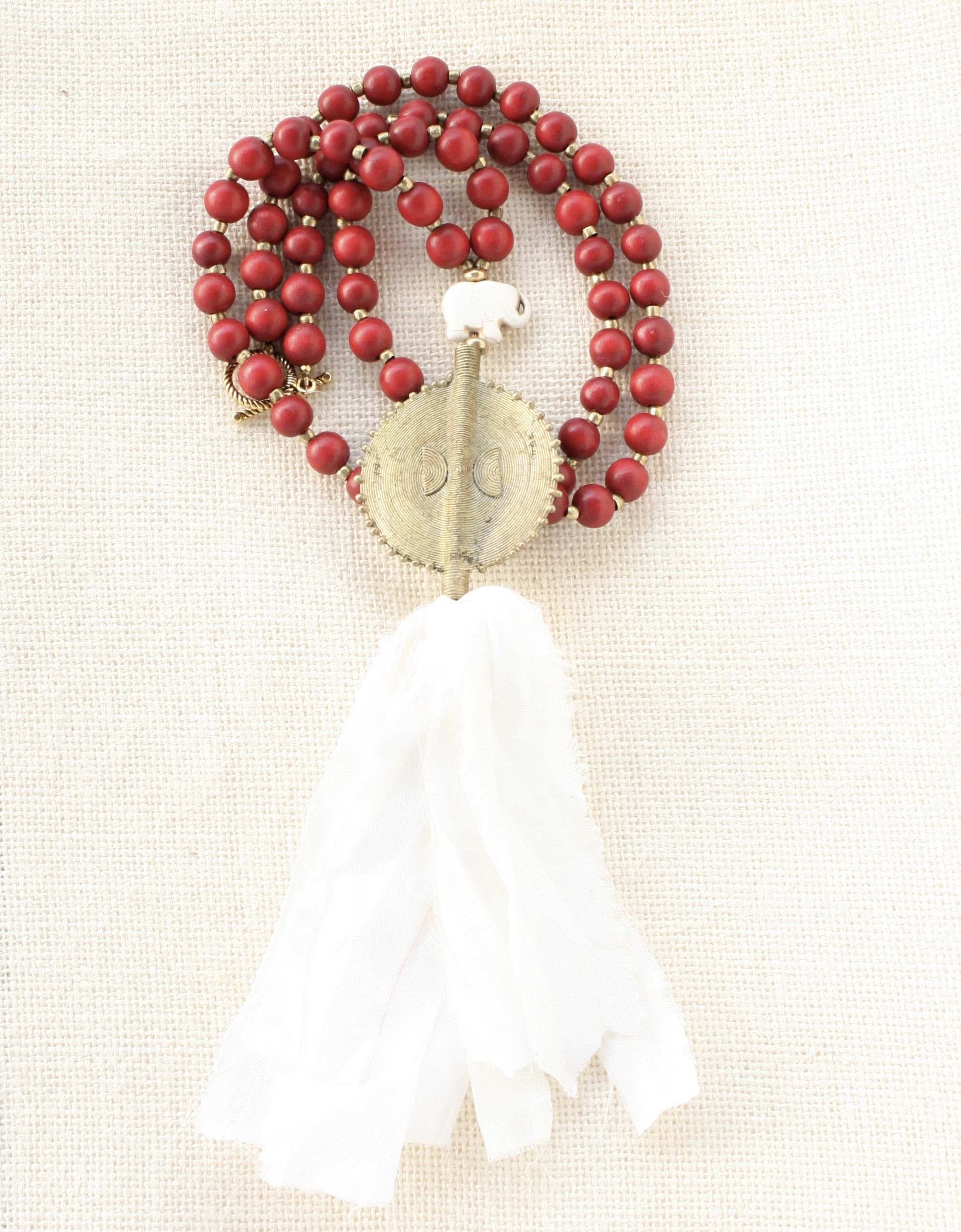 justly crimson ten love villages thousand ethical necklace bead collections necklaces